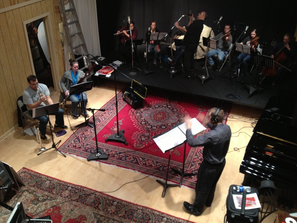 Photo of Jeffrey Dokken conducts the chamber orchestra while recording engineer Jeff Gruber adjusts microphones.
