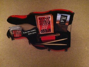 Photo of A viola case is used for transporting and displaying the CD and books associated with A Roadkill Opera and If You See Roadkill, Think Opera
