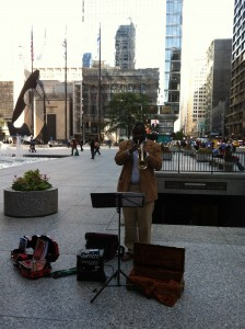 Photo of A busker in Chicago hosted a popup display promoting A Roadkill Opera as well as If You See Roadkill, Think Opera