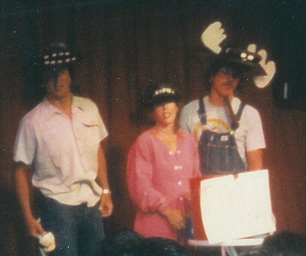 Photo of Bison, Bear, and Moose converse in the 1988 comedy sketch In A Clearing featuring (left to right) Stephan Alexander Parker, Holly Danner, and Ed Bachtel