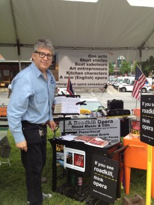 Photo of Stephan Alexander Parker in the tent display for A Roadkill Opera at the May 2013 Gaithersburg Book Festival in Maryland