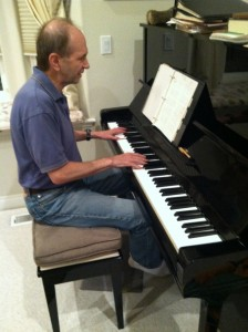 Photo of David Greenstein, a multiple threat: singer, songwriter, pianist, seen here at his piano performing an original song