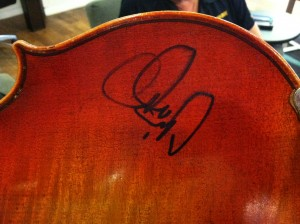 Photo of mark on the back of the instrument. Looking on the internet, the mark appears similar to  some signatures of Charlie Daniels.
