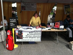 Photo of DJ Choupin hawking If You See Roadkill, Think Opera, at the 2014 Gaithersburg Book Festival.