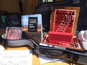 Photo of the gray, cello-shaped viola case from McKay's of Nashville made a fine tabletop display for A Roadkill Opera at the 2014 Gaithersburg Book Festival.