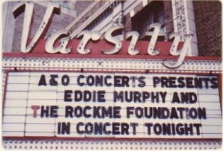 "Photo of the Varsity Theater marquee reading ""A&O Concerts Presents Eddie Murphy and The Rockme Foundation in Concert Tonight"""