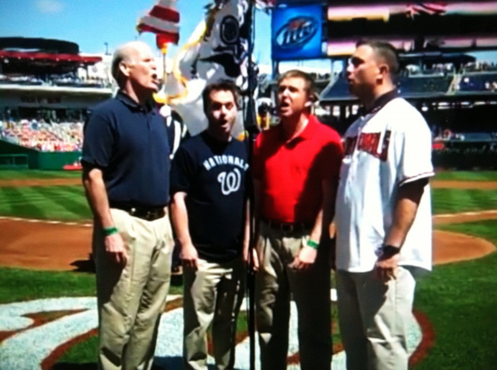 "Four members of open5ths sing ""The Star-Spangled Banner"" before a Washington Nationals-Milwaukee Brewers game on April 17, 2010, at Nationals Park in Washington, D.C. From left to right is Peter Rogers, bass; Ed Hoover, tenor; Jeff Dokken, tenor; and Andy Pulliam, bass."