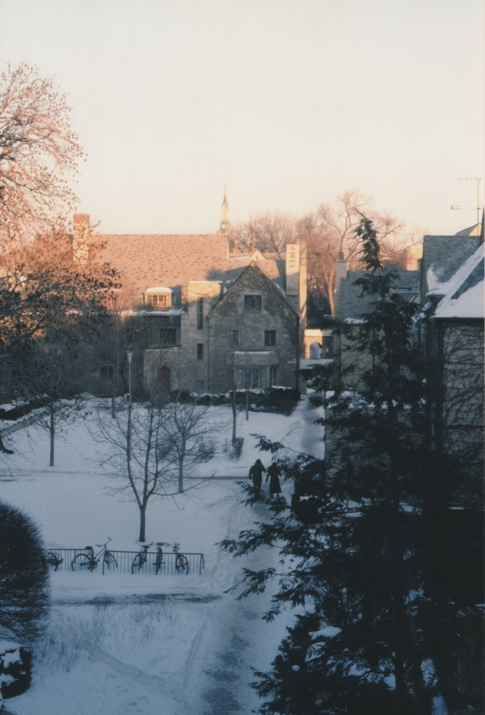 Photo of winter scene, a snowy courtyard of a traditional college quad