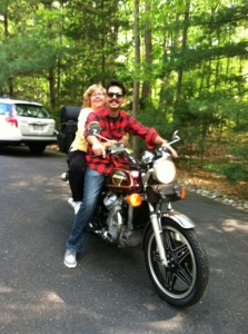 Photo of DJ Choupin and RIch Gaudiosi on a motorcycle