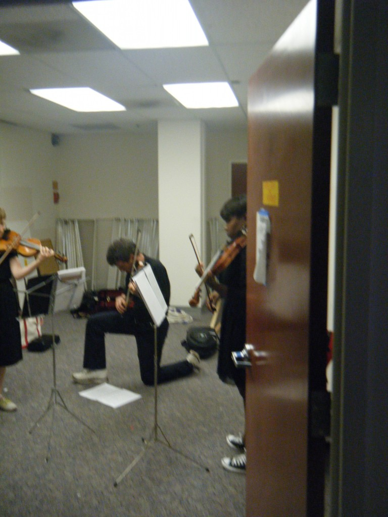Photo of musicians warming up