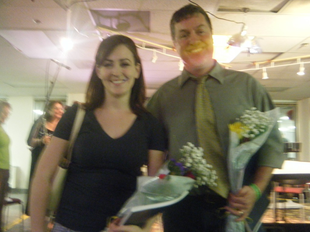Photo of Wehrmeyer and Timpane holding bouquets