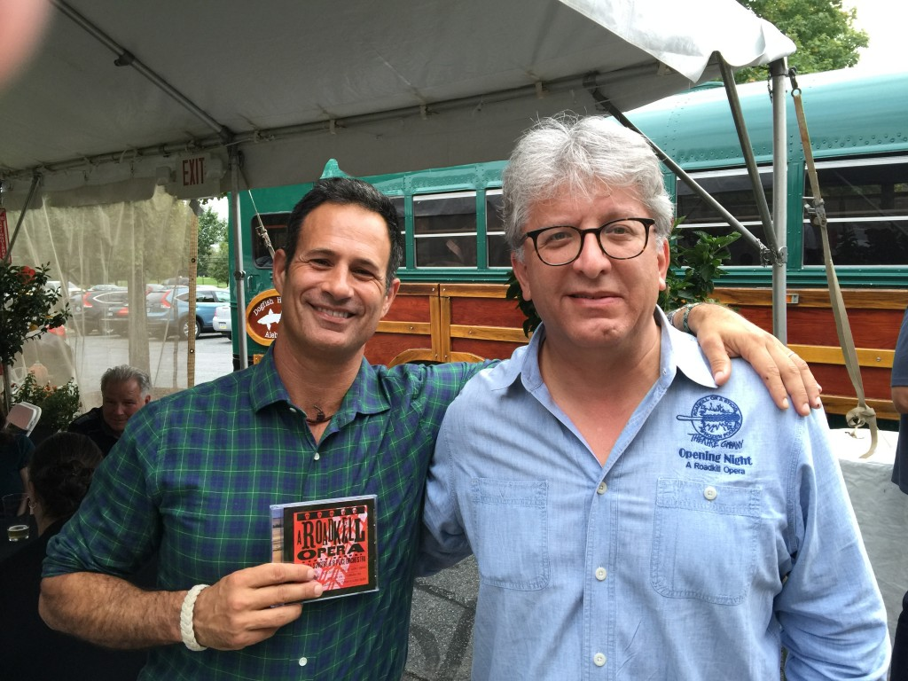 Photo of Sam Calagione and Stephan Alexander Parker with a CD of the studio recording of A Roadkill Opera