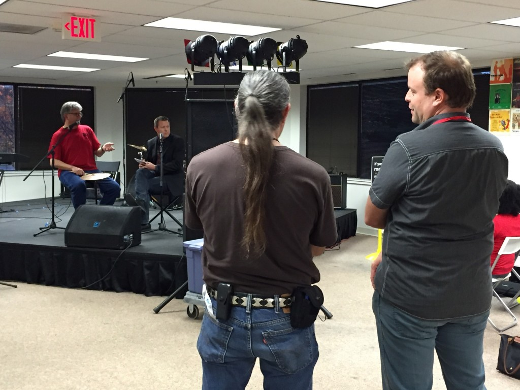 Photo of Bryan Jerome Murphy and unidentified stage manager watching Parker & Dokken on stage at Artomatic 2015