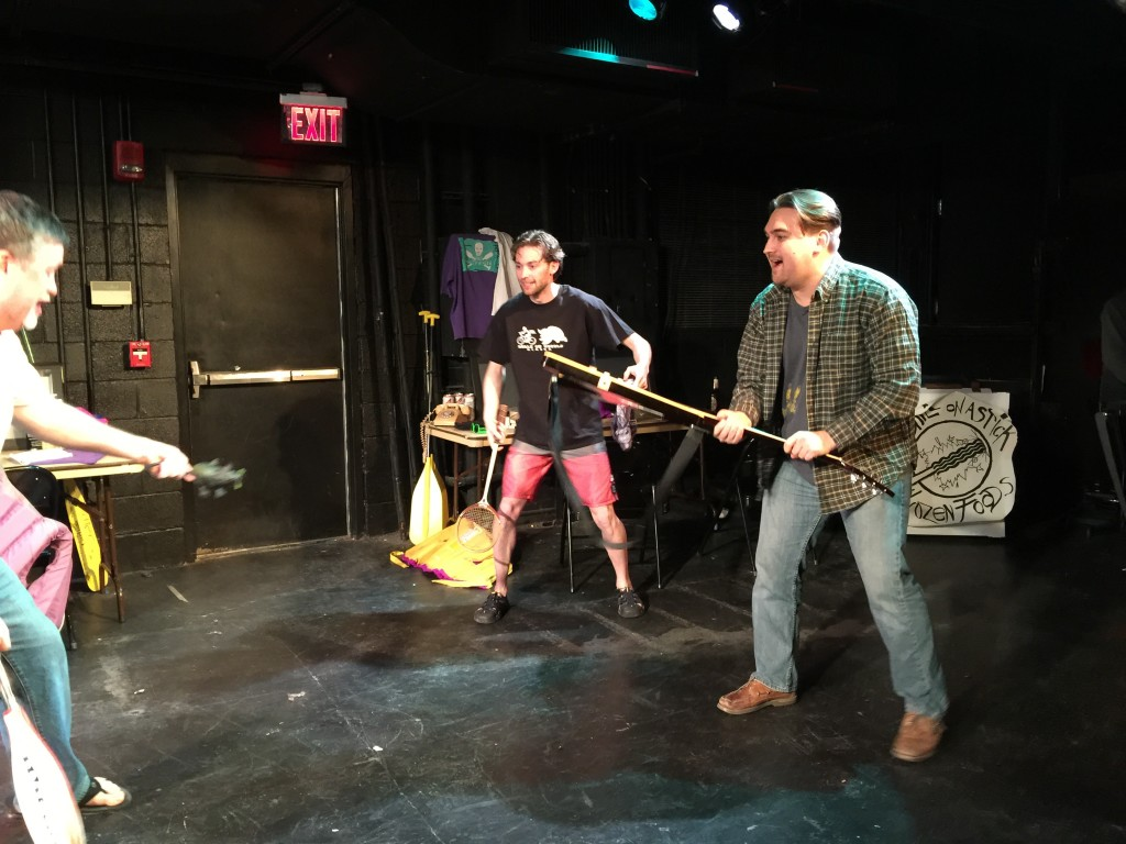 Photo of Stephan, Eddie, and Dave batting around a rubber rat