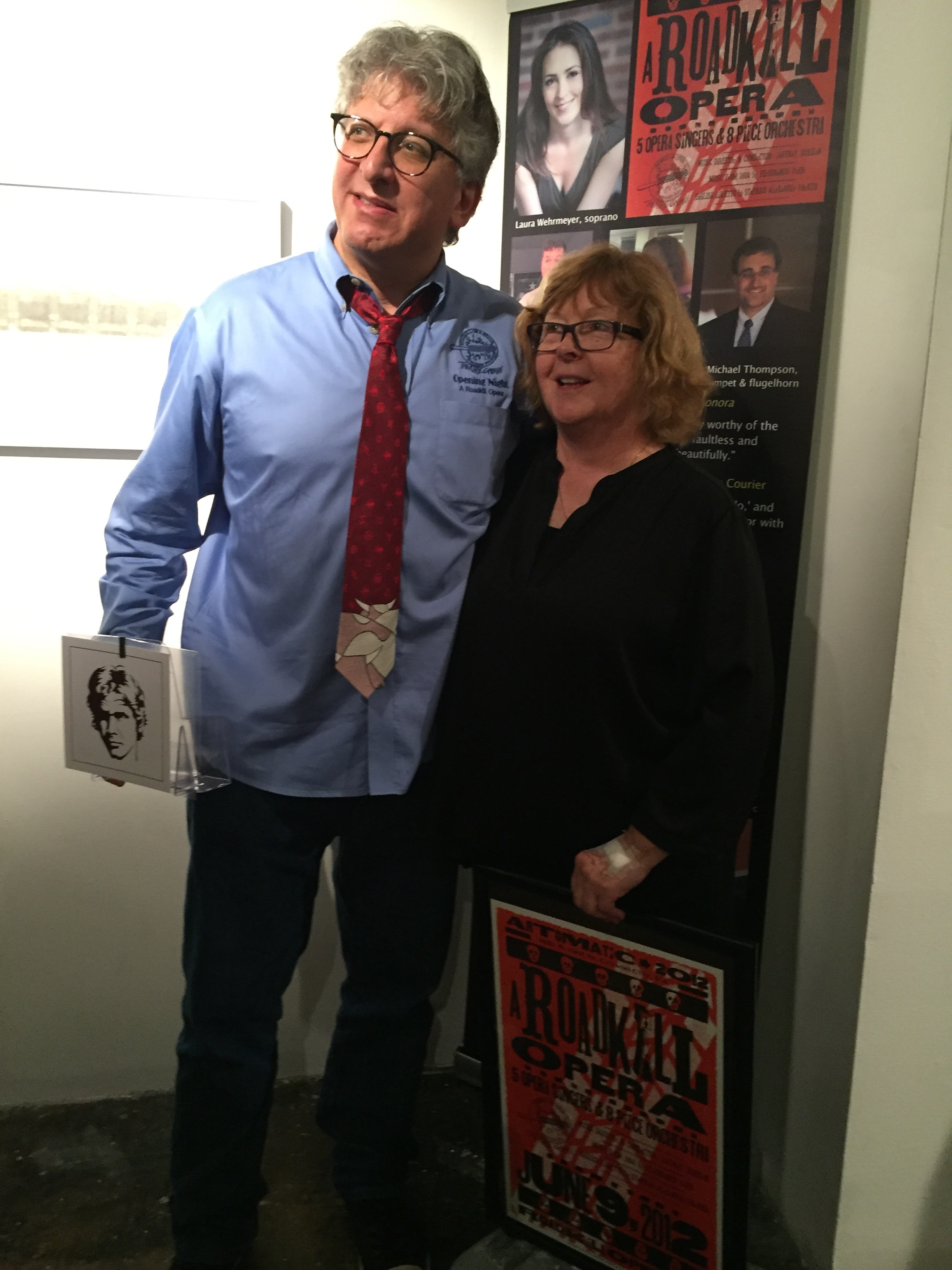 Photo of Parker and Choupin standing in front of hammer at A Roadkill Opera world premiere performances in January 2016 at the Mead Theater Lab at Flashpoint in Washington, DC