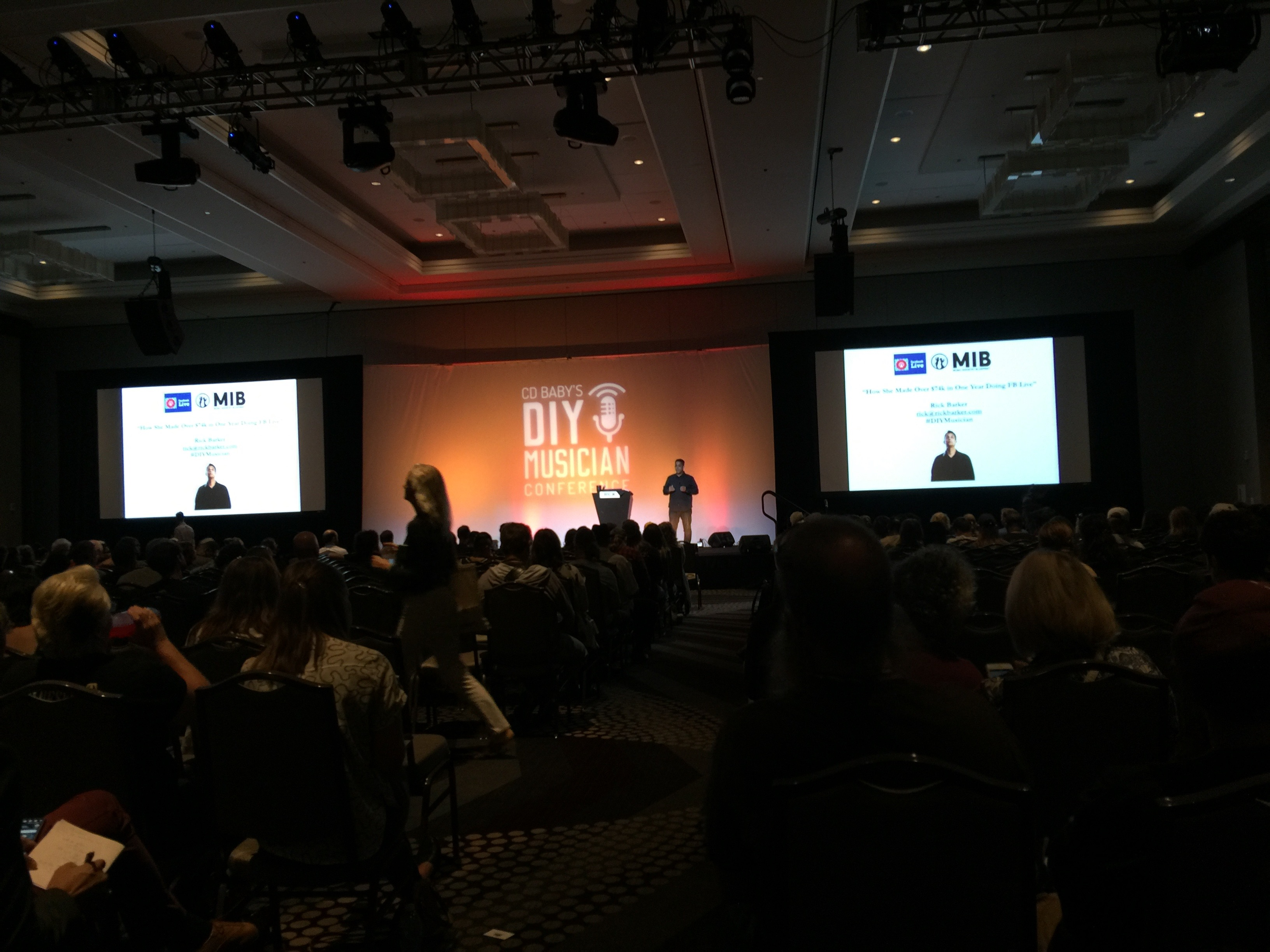 Photo of Rick Barker keynote on huge stage with la crowd of 1,000 to 1,500 people at CD Baby's DIY Musicians Conference 2017 in Nashville, Tennessee