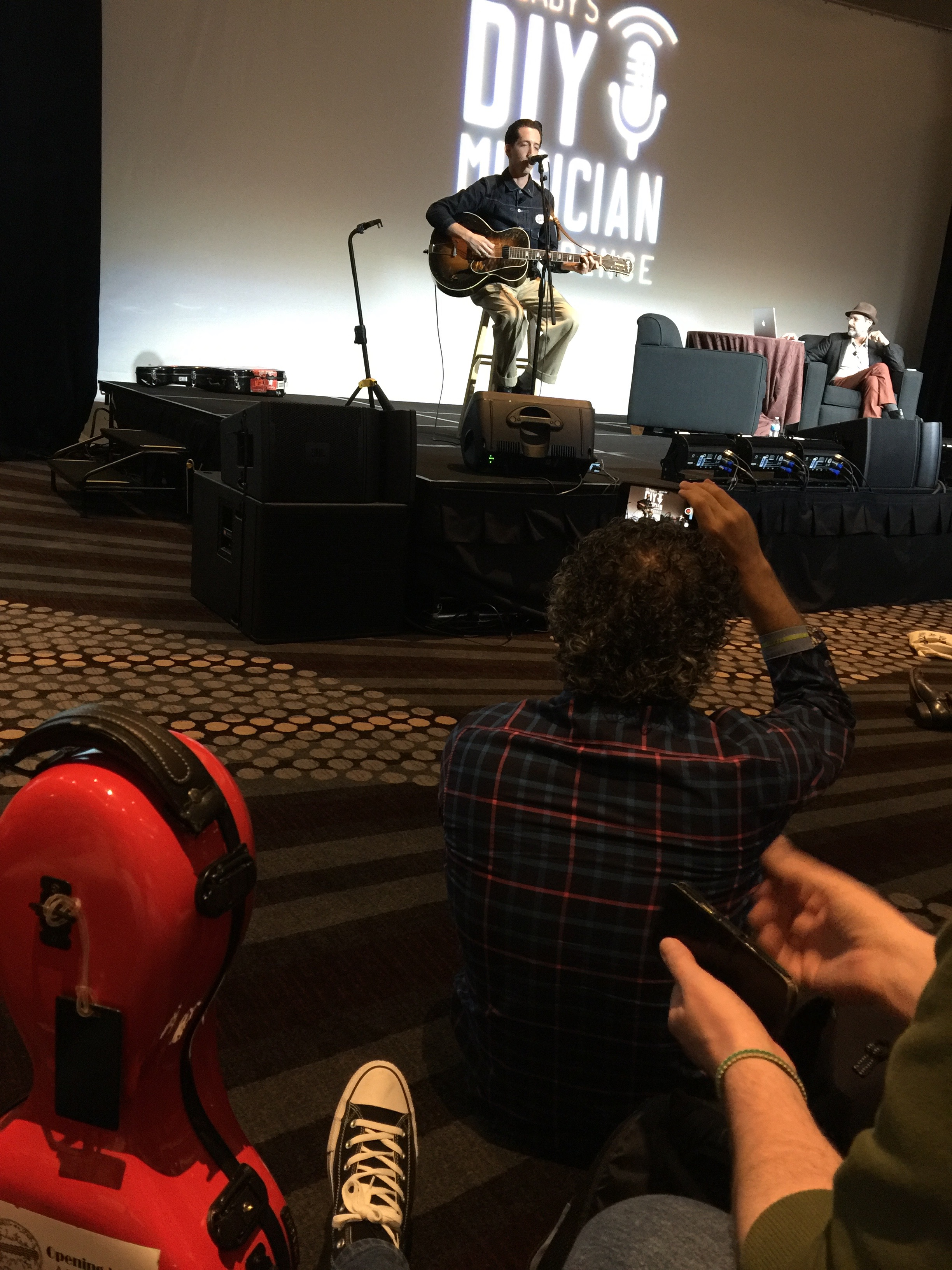 Photo of Pokey LaFarge and Bob Boilen with Dmitri Vietze watching at CD Baby's DIY Musicians Conference 2017 in Nashville, Tennessee